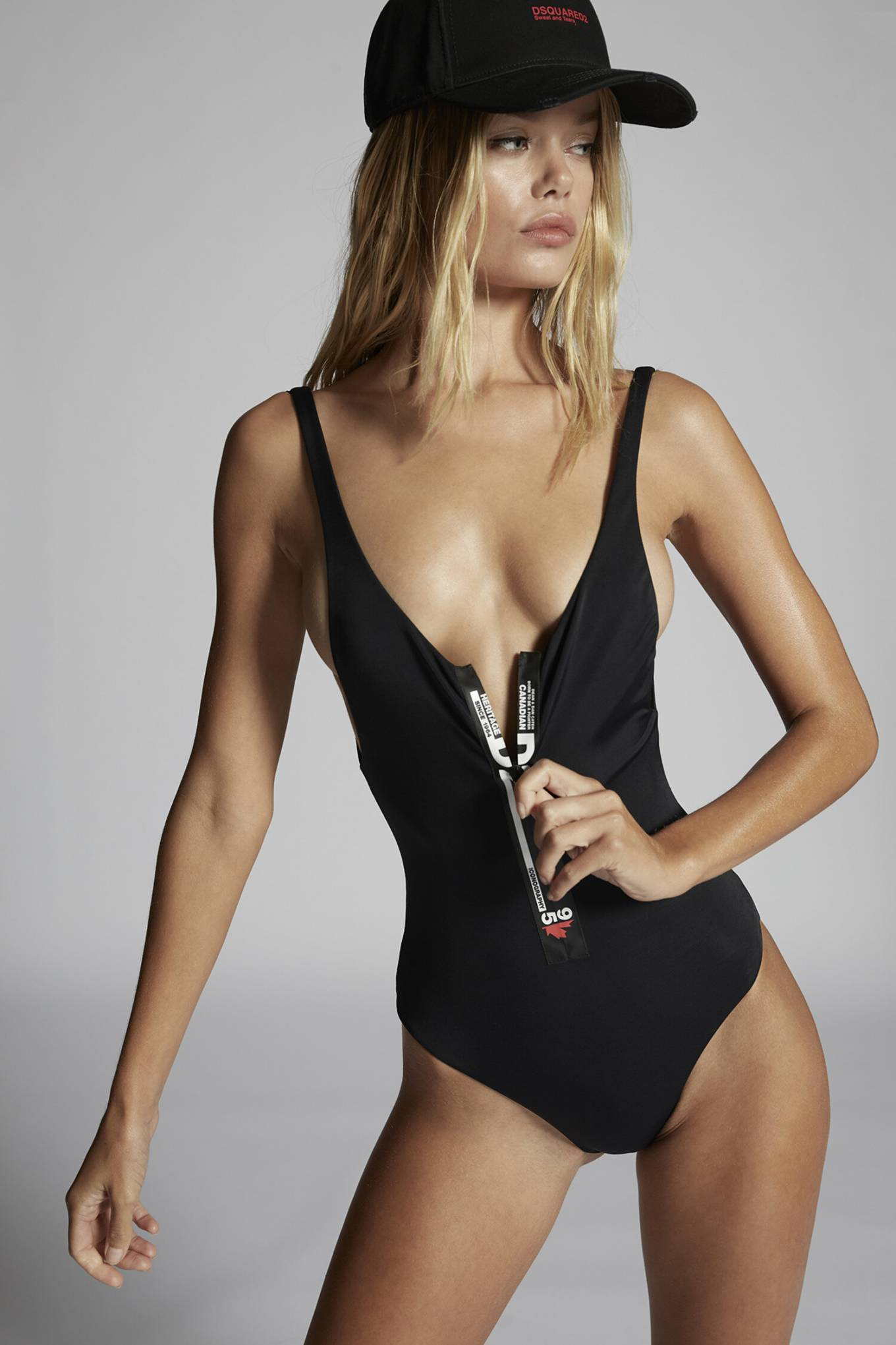 Frida Aasen donning a plunging bodysuit with Polyamide, thin shoulder strap and brand logo