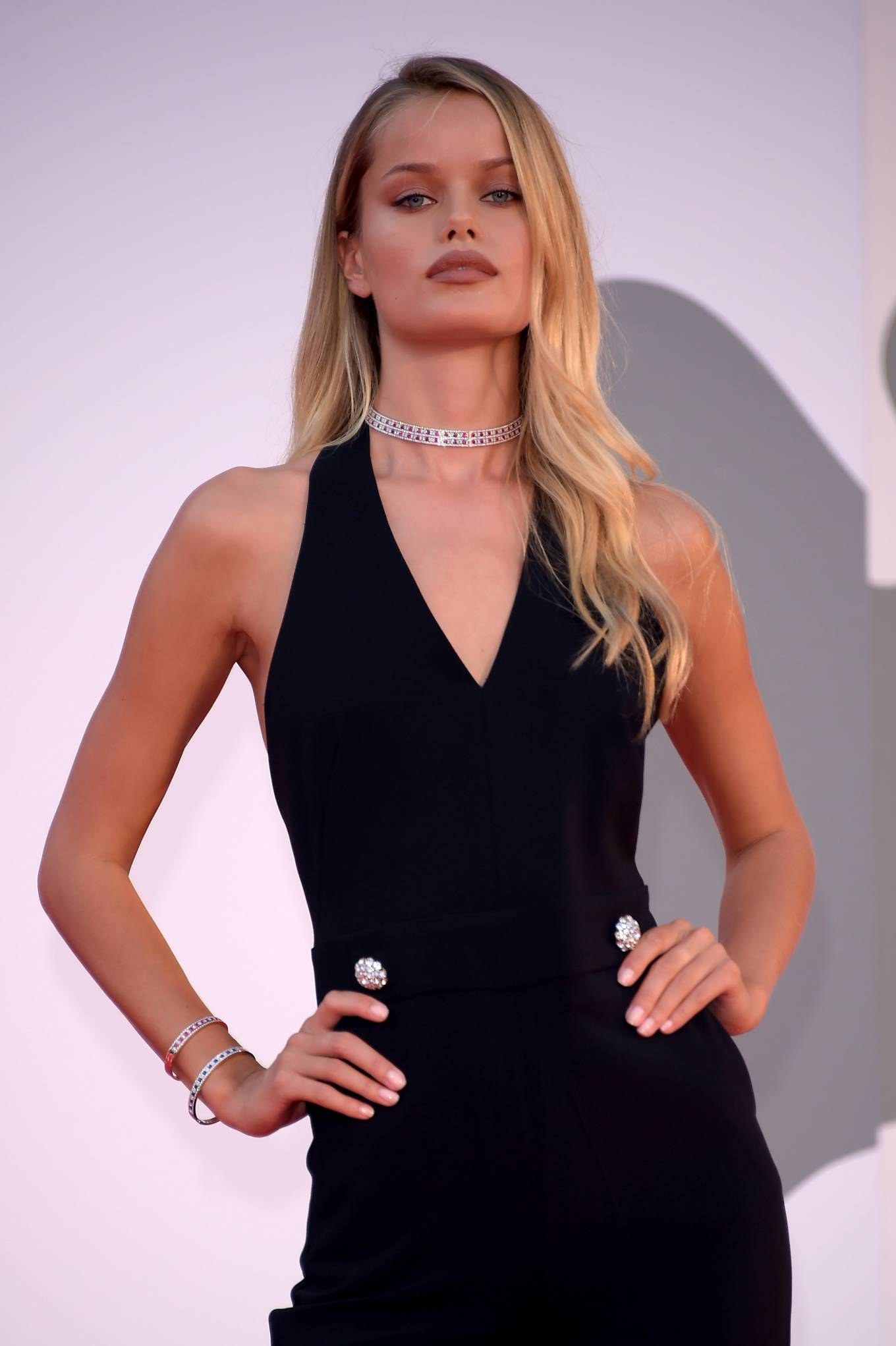 Frida Aasen wearing silver open toe sandals with high heel and wide strap
