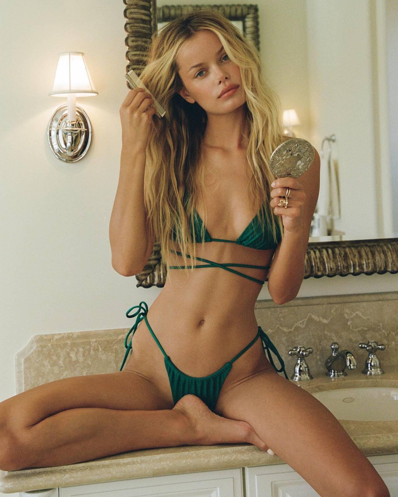 Frida Aasen donning skimpy emerald green ruched bikini bottom with tied waist