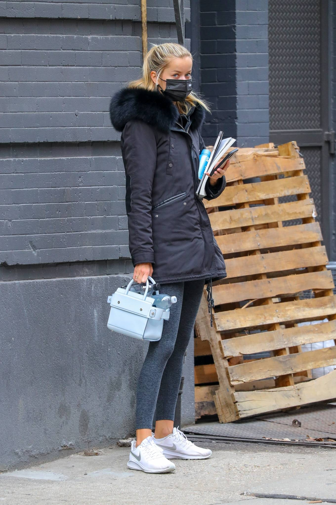 Frida Aasen donning brand logo white Nike lace-up sneakers