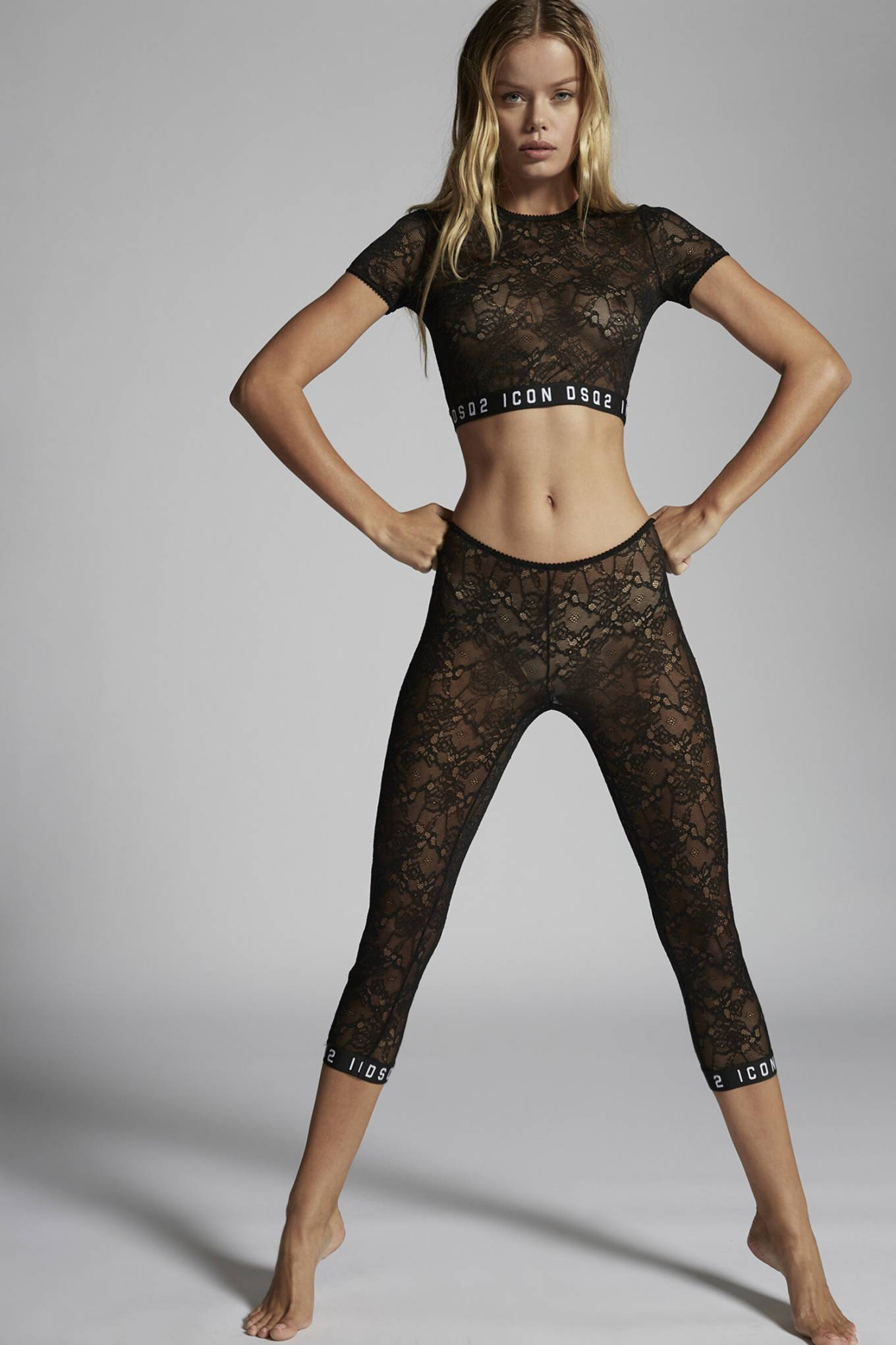 Frida Aasen wearing sheer black lace embroidered skinny leggings with brand logo