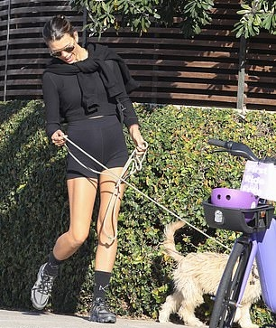 Georgia Fowler wearing brand logo black grey lace-up sneakers by Nike with chunky sole