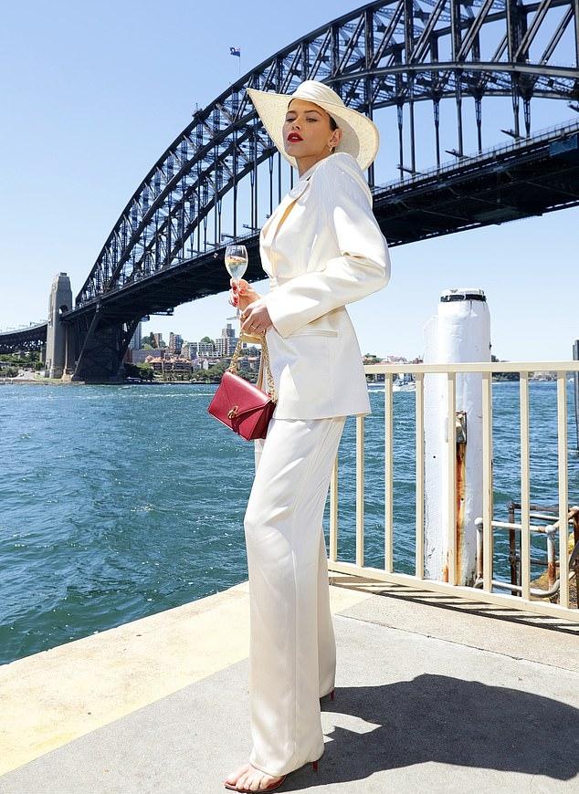 Georgia Fowler wearing white high rise trousers