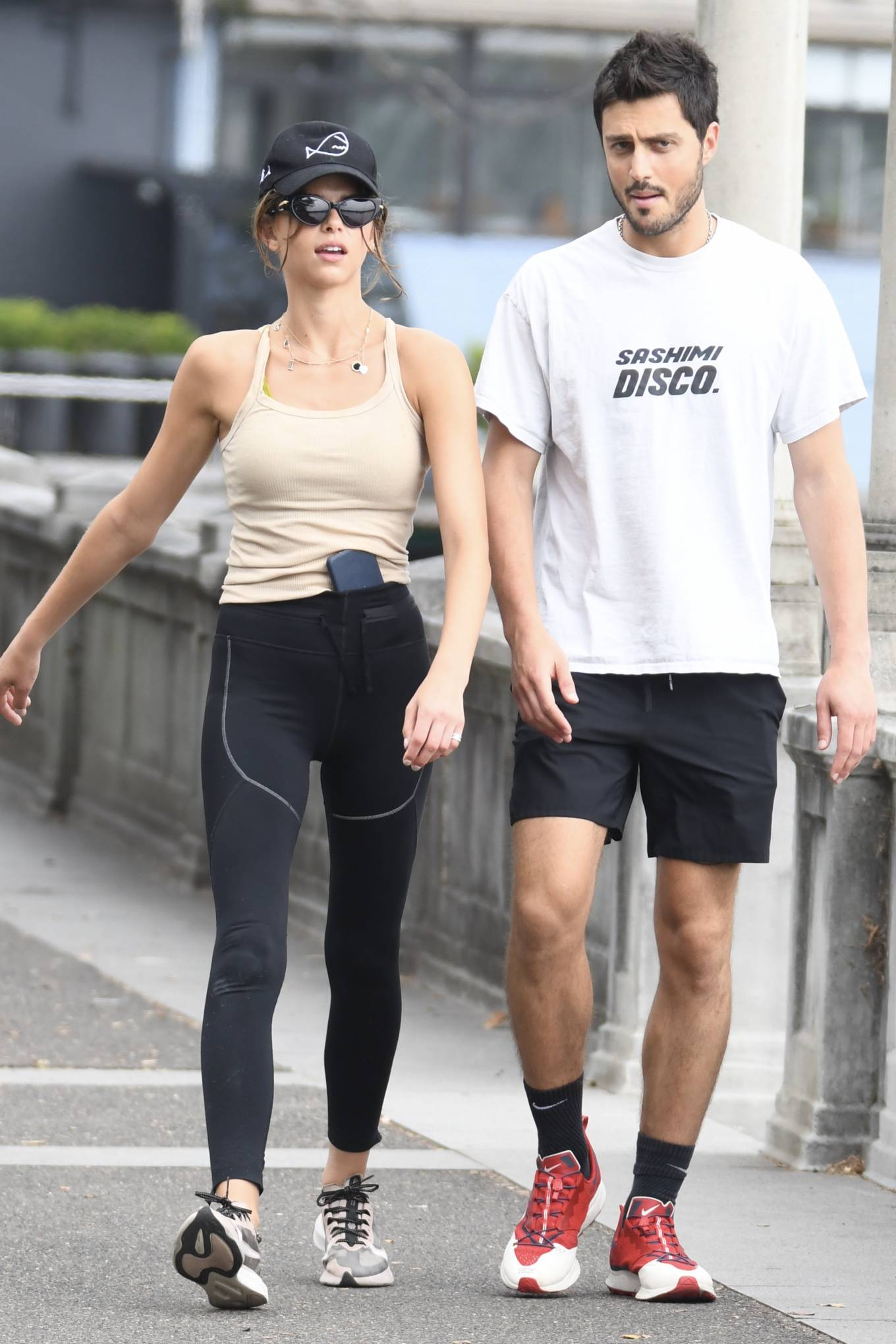 Georgia Fowler donning round white and black lace-up sneakers