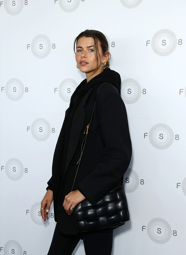 Georgia Fowler donning sportswear inspired black high rise ankle length workout leggings with a stretch fabric