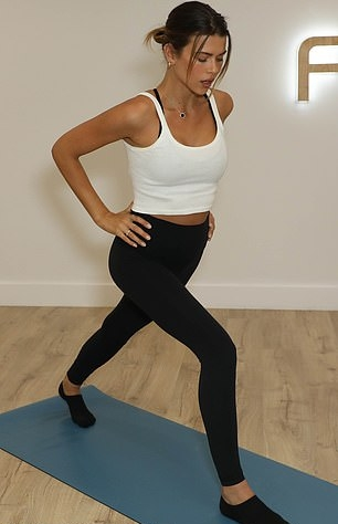 Georgia Fowler rocking sportswear inspired black high rise ankle length workout leggings with a stretch fabric