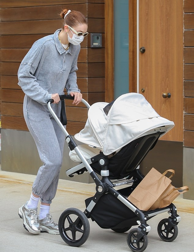 Gigi Hadid, Ash sneakers, silver sneakers, grey sweatshirt, white Dmy by Dmy sunglasses, color block, round, lace-up, grey joggers. Gigi Hadid wearing round silver lace-up sneakers by Ash