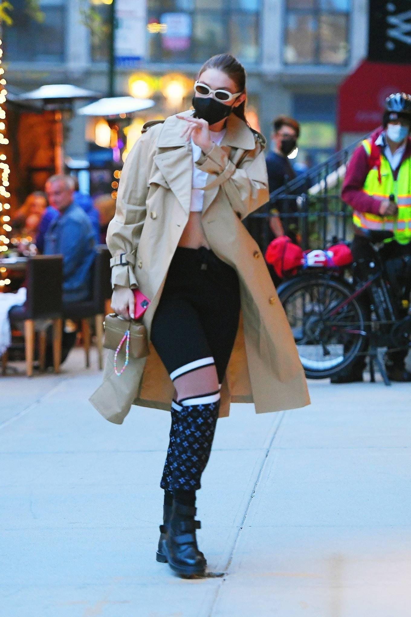 Gigi Hadid wearing round black leather ankle combat boots by Dr. Martens with cuban heel