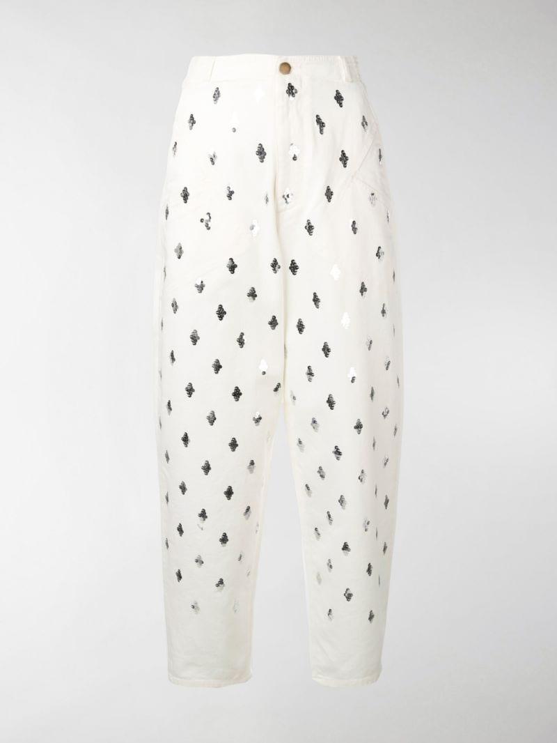 Gigi Hadid rocking round white Reebok lace-up sneakers