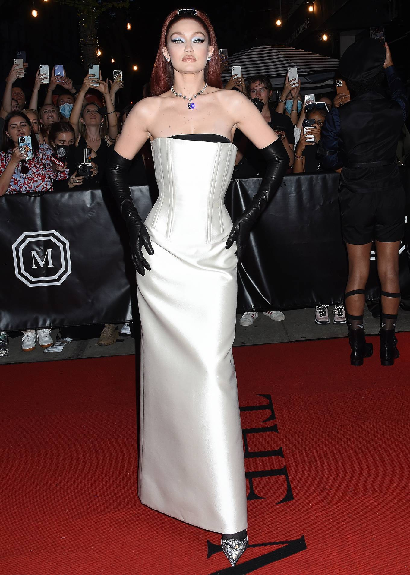 Gigi Hadid rocking crystal embellished Prada satin slingback sandals with kitten heel