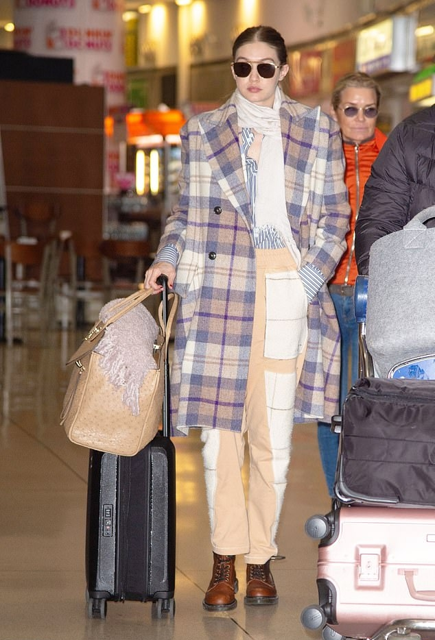 Gigi Hadid donning Beige Vivienne Westwood baggy pants with patchwork