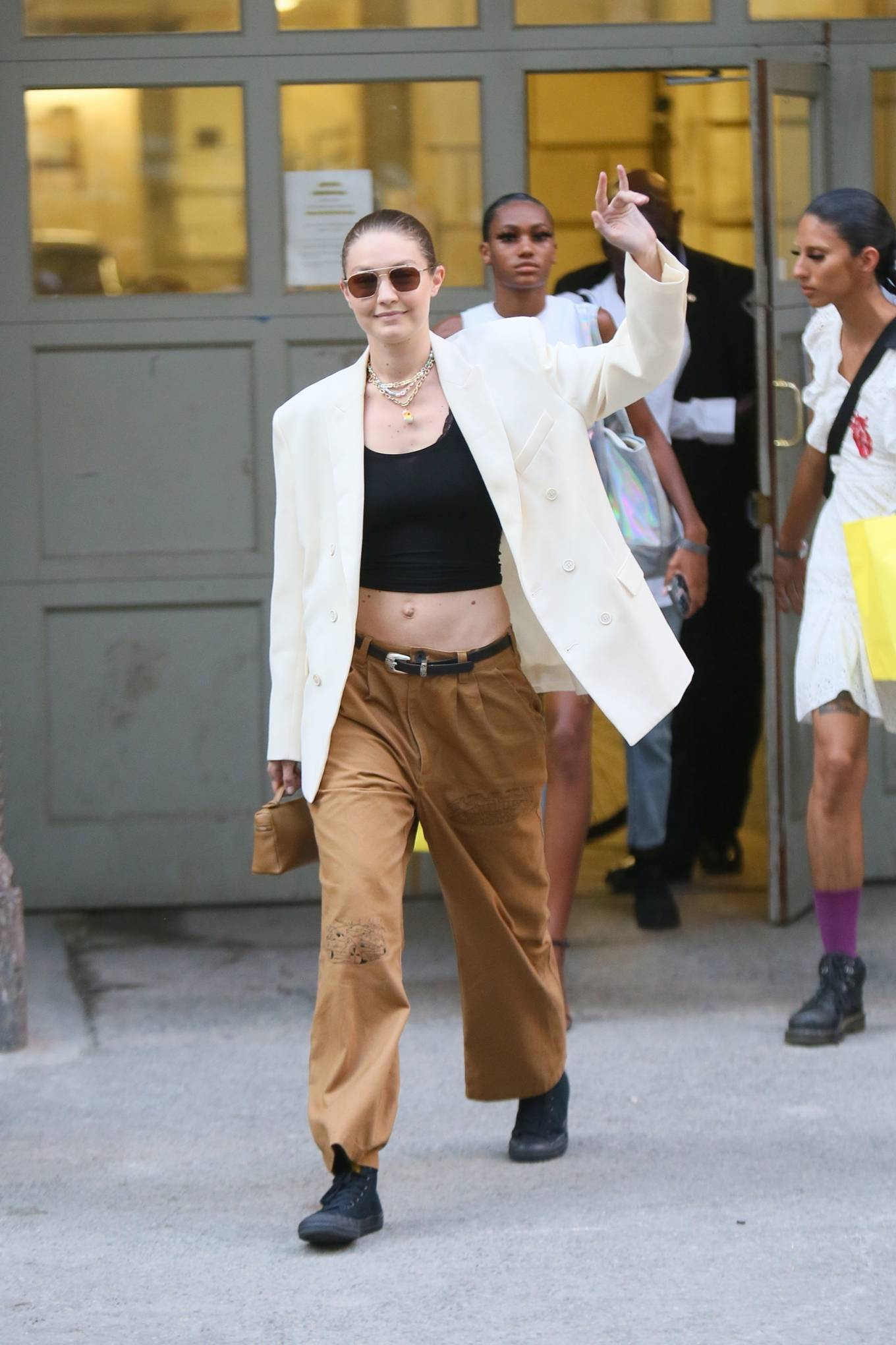 Gigi Hadid donning round black leather lace-up sneakers