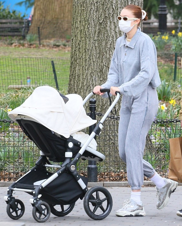 Gigi Hadid wearing round silver lace-up sneakers by Ash