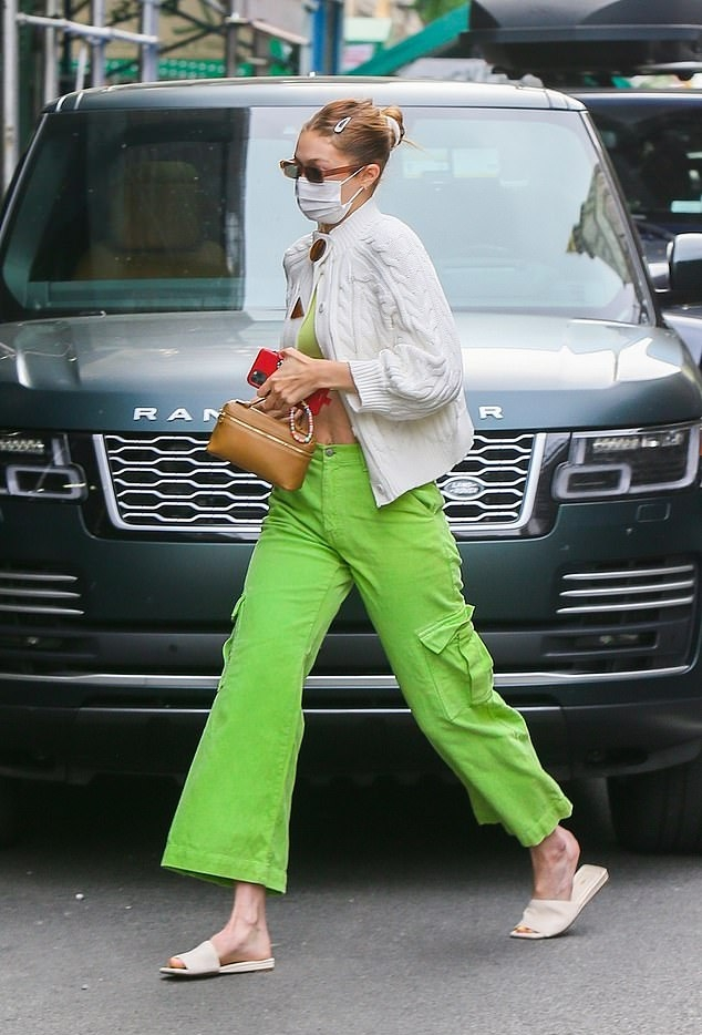Gigi Hadid donning square off white leather slip on slippers with flat heel