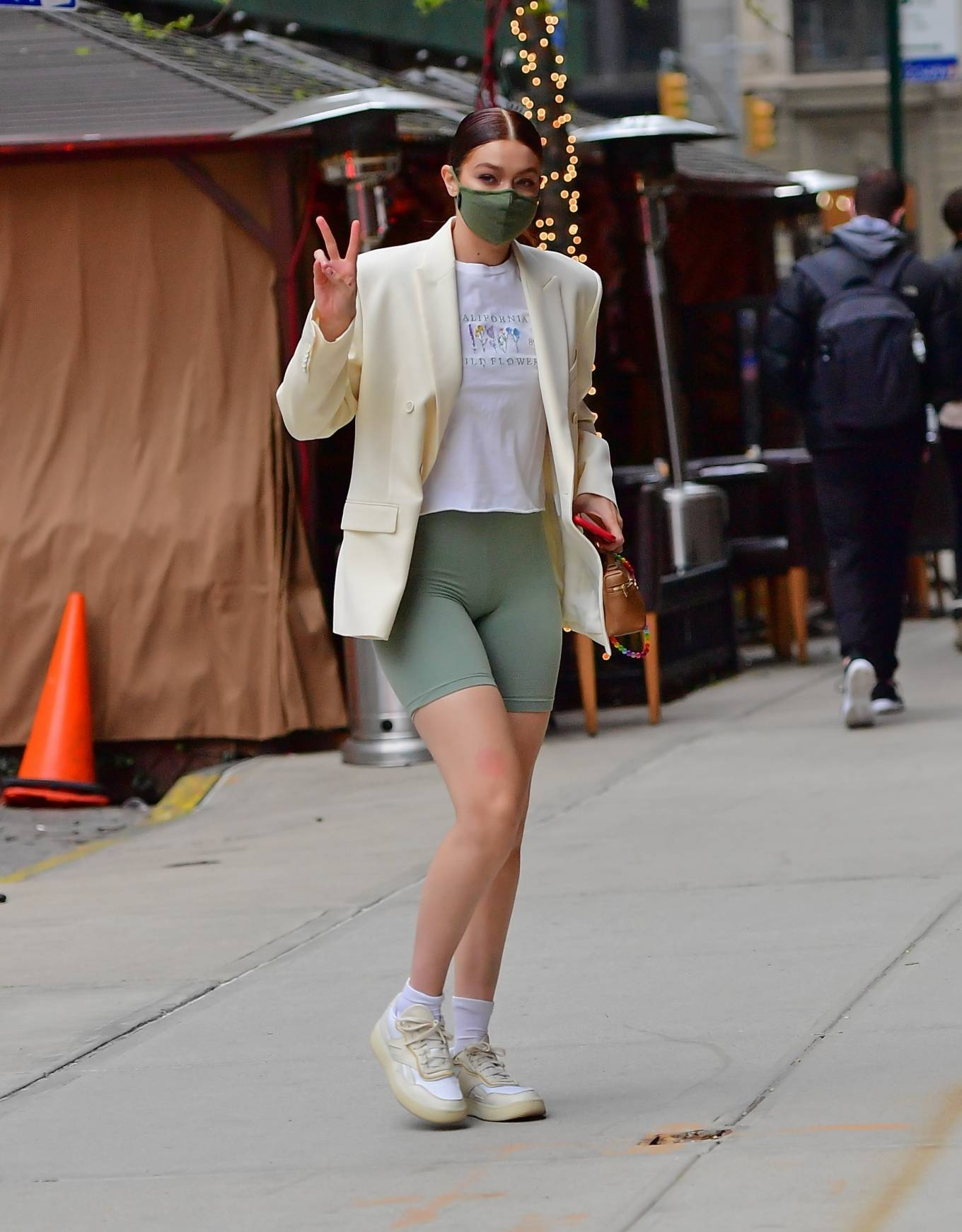Gigi Hadid rocking round off white Reebok lace-up sneakers with flat heel