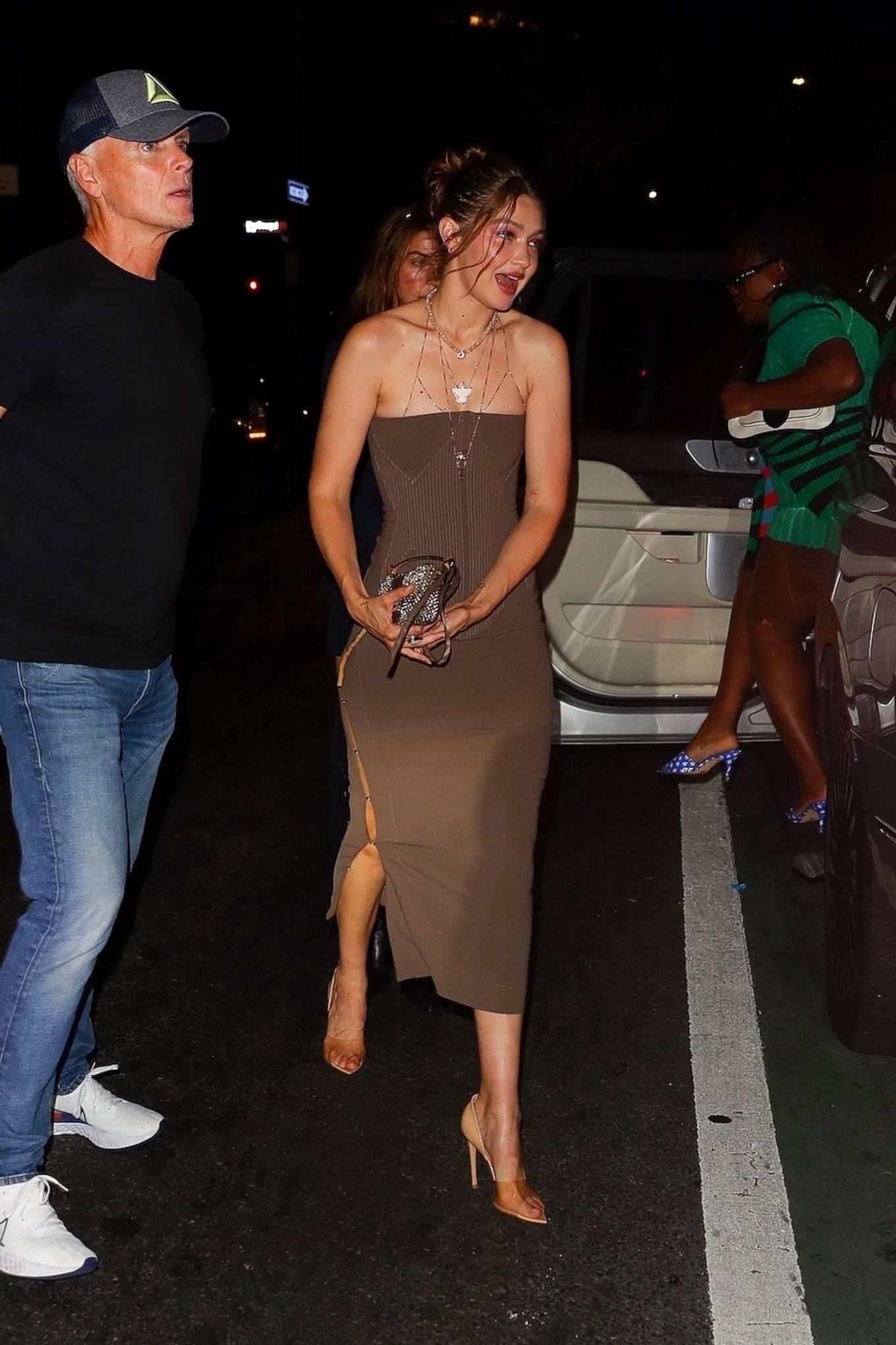 Gigi Hadid donning pointed beige completely see-through slip on pumps by Gianvito Rossi with stiletto heels