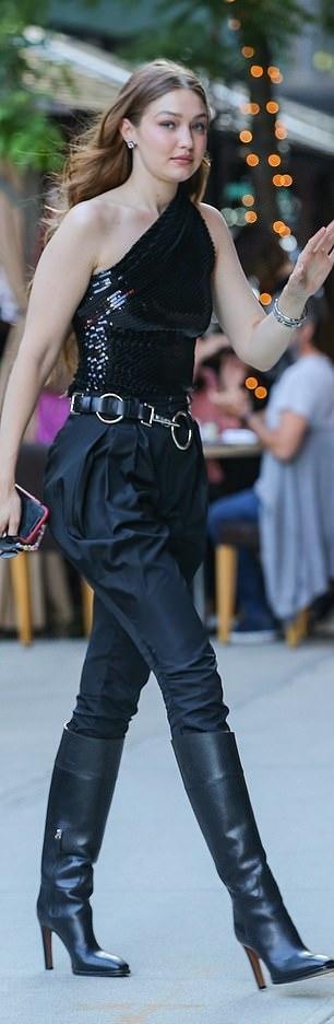Gigi Hadid wearing pointed black rain boots