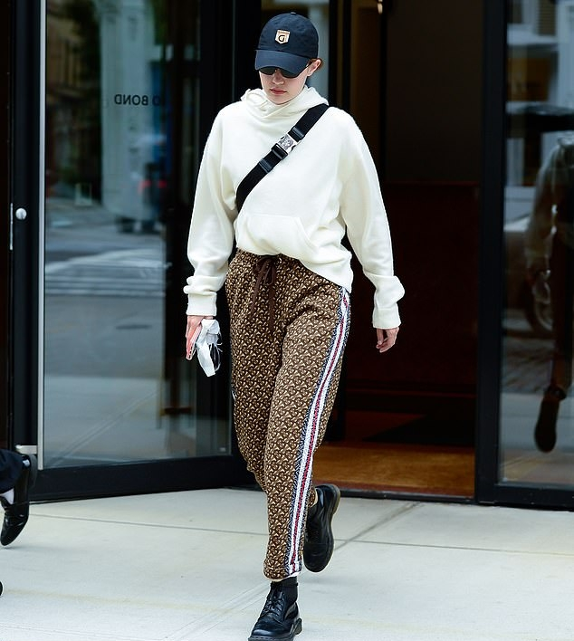 Gigi Hadid rocking a Cream hooded woolen hoodie with a woolen fabric and extra long sleeves