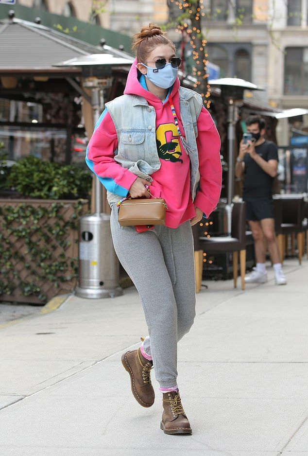 Gigi Hadid wearing round brown leather ankle boots by Dr. Martens while out and about in New York