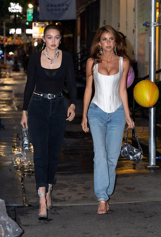 Gigi Hadid wearing sharp slip on pumps with stiletto heels