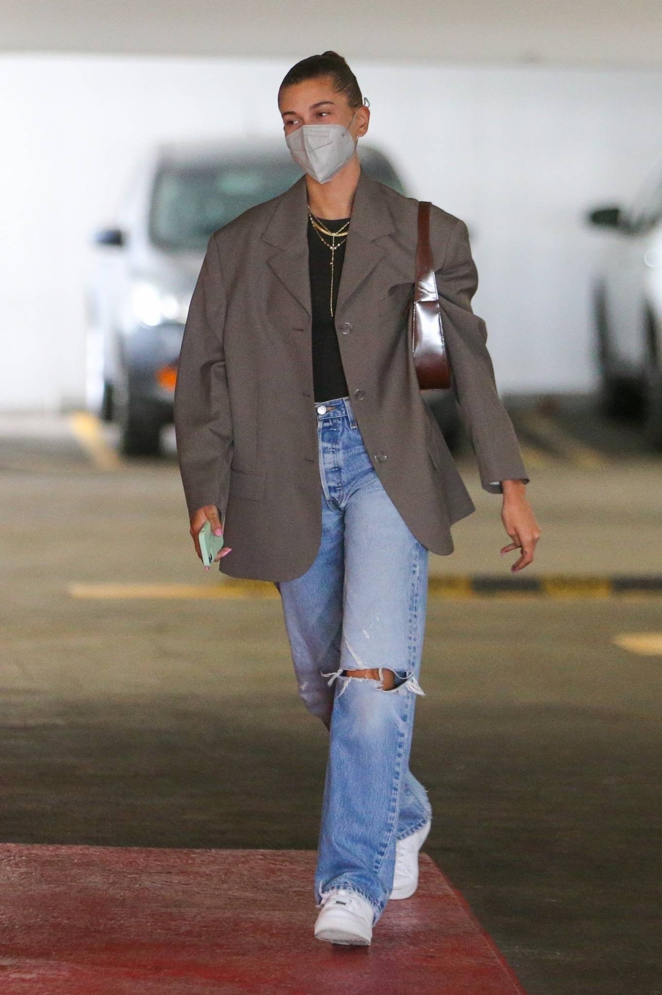 Hailey Baldwin wearing round white Nike lace-up sneakers with flat heel