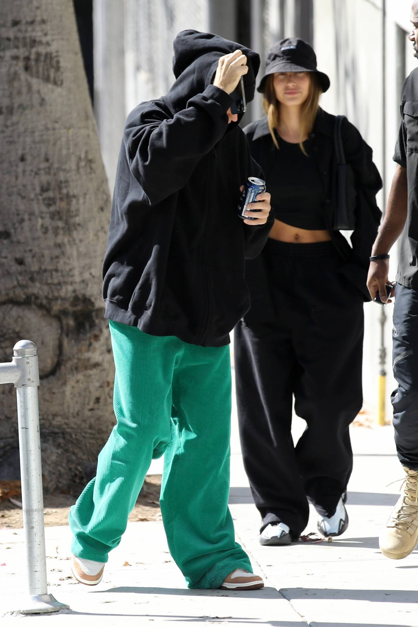 Hailey Bieber rocking a black cotton crop top that make the most her midriff while out and about in Los Angeles