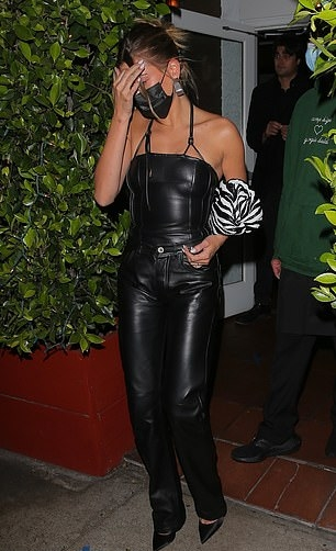 Hailey Baldwin rocking sharp black leather slip on pumps by Casadei with high heel