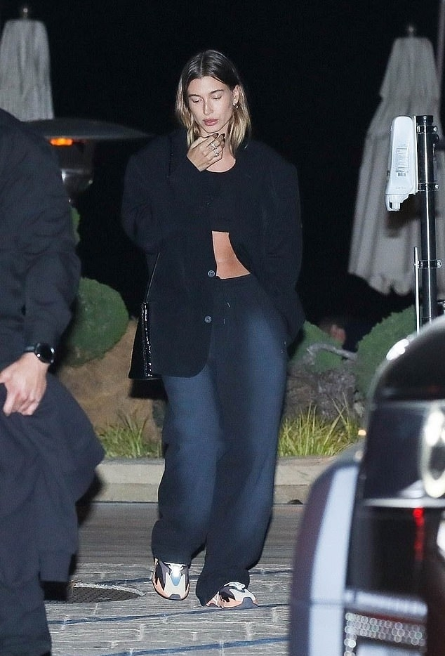 Hailey Baldwin donning a oversized black structured Balenciaga woolen blazer with long sleeves, peak lapel collar and button front while out and about in Malibu