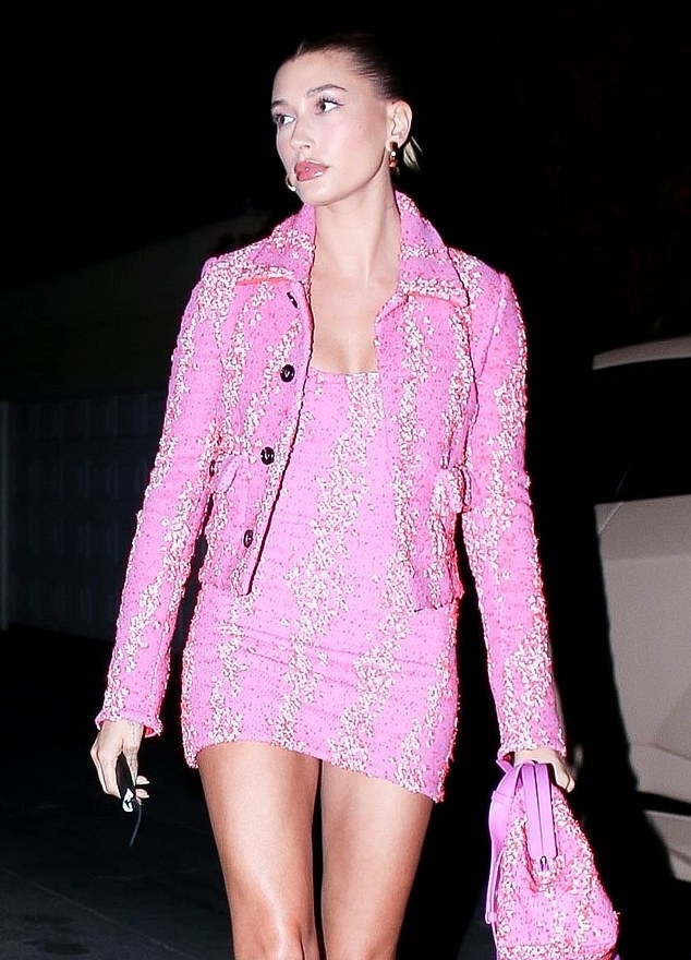Hailey Baldwin wearing a fitted pink button up Bottega Veneta nylon Jacket with a spandex fabric, full sleeves, shirt collar and embellished