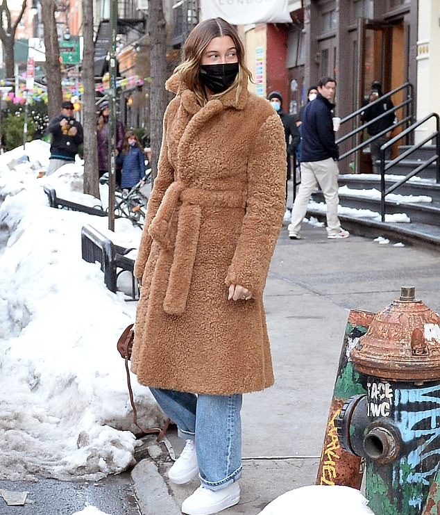Hailey Bieber donning a oversized blue woolen scarf with a knit fabric and fringed ends