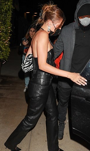 Hailey Baldwin, black  trousers, leather, Attico  trousers, black Casadei pumps, figure hugging black Petar Petrov corset, 5 pocket, full length, high rise, straight fit, long legs, black  pants, Attico  pants, black Bottega Veneta clutch