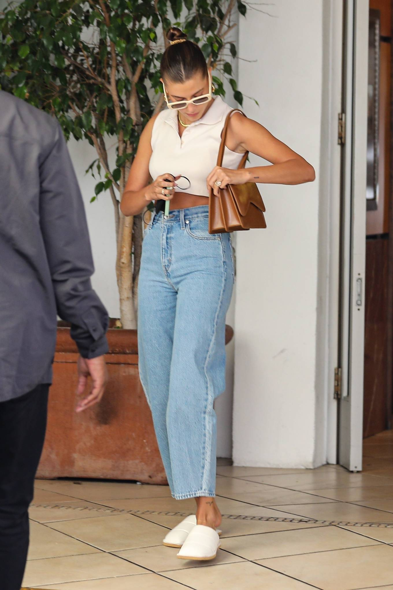 Hailey Baldwin rocking quilted white leather slip on slippers by Dries Van Noten