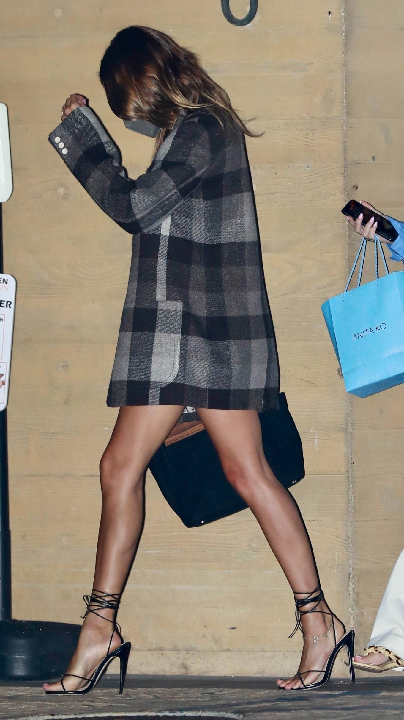 Hailey Bieber rocking a oversized gradient unbuttoned woolen blazer with long sleeves, peak lapel collar and button front