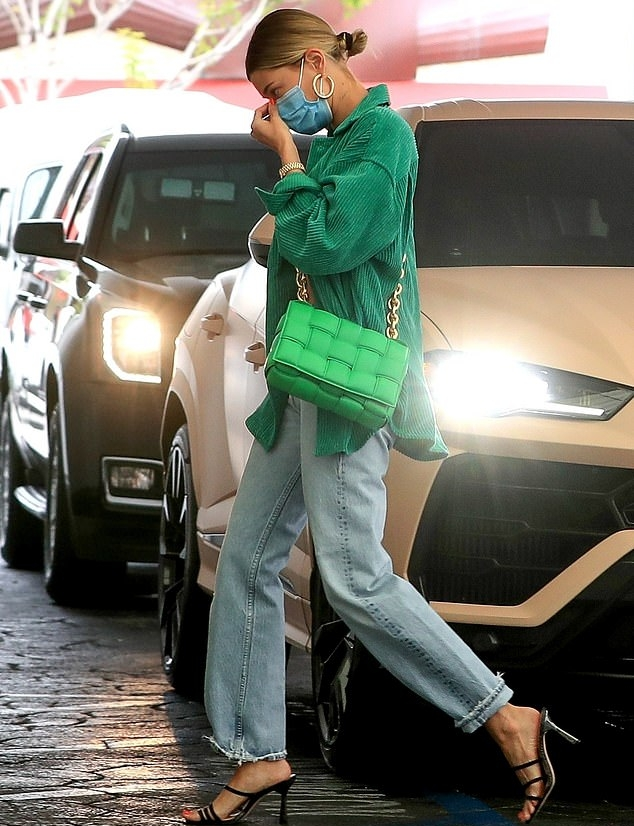 Hailey Bieber rocking strappy black snakeskin leather open toe sandals by Dillard's with high heel and thin straps