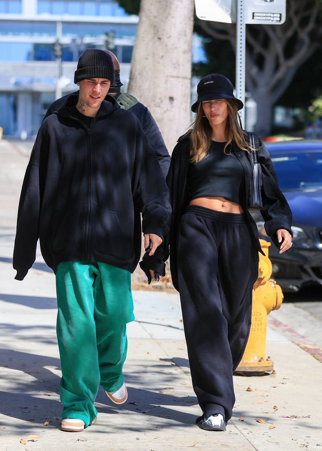 Hailey Bieber rocking round white grey slip on sneakers by Adidas x Yeezy with chunky heel