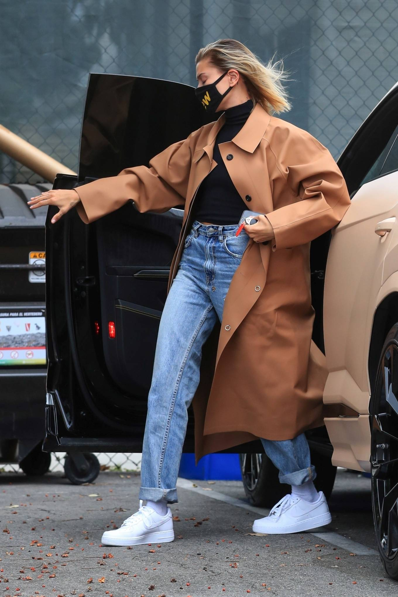 Hailey Baldwin donning white Nike lace-up sneakers