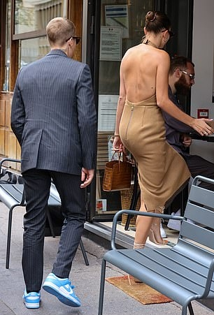 Hailey Baldwin donning a flattering nude dress with a halter neck