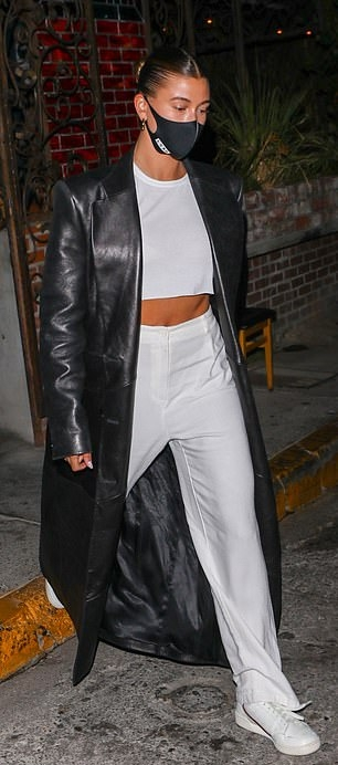 Hailey Bieber rocking round white lace-up sneakers
