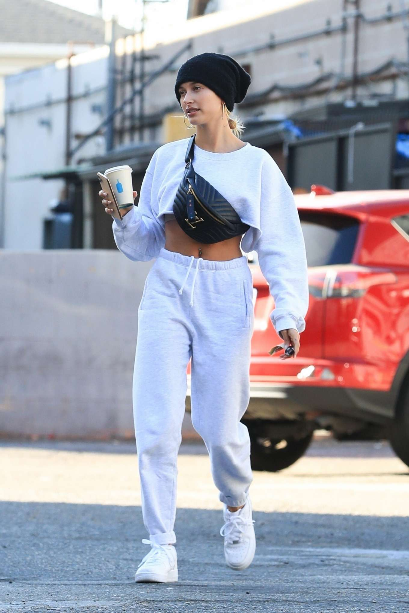 Hailey Baldwin donning a Oversized grey crop top with a woolen material, full sleeves and a crew neck
