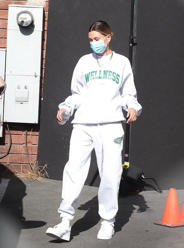 Hailey Bieber rocking baggy white ribbed trim hem sweatpants