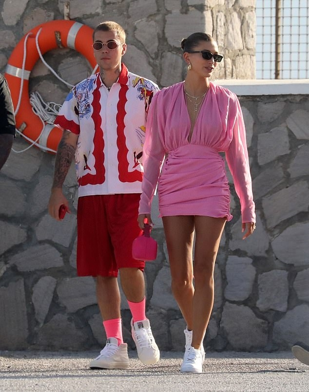 Hailey Baldwin donning round white Nike lace-up sneakers with flat heel