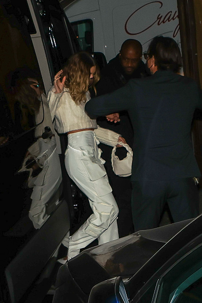 Hailey Baldwin donning a white cropped sweater with a knit fabric and full sleeves