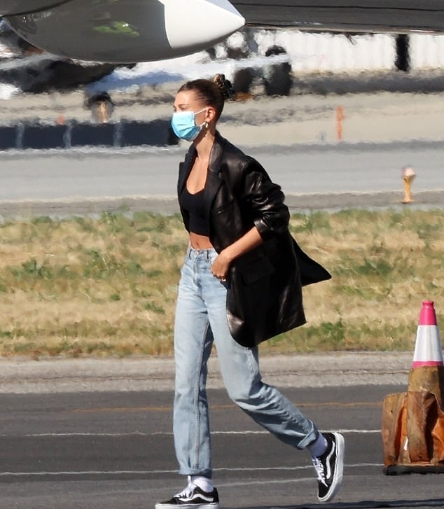 Hailey Baldwin rocking a black basic crop top with a scoop neck