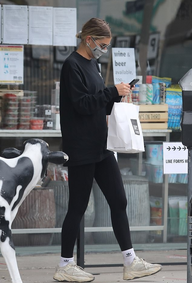 Hailey Bieber wearing a Oversized black Union sweatshirt with extra long sleeves and a crew neck