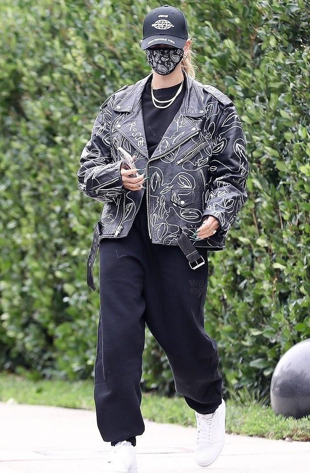 Hailey Bieber donning Baggy black ribbed trim hem sweatpants by Alexander Wang with ribbed trim hem