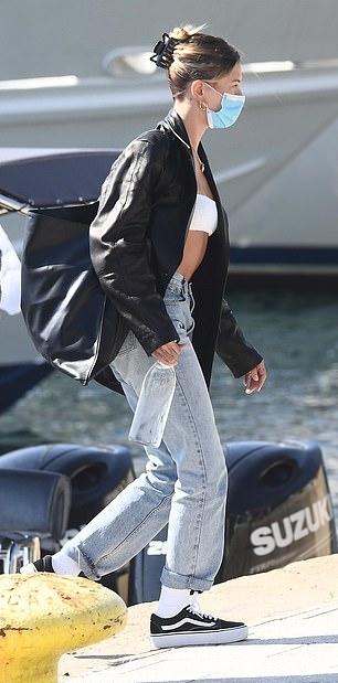 Hailey Baldwin rocking straight fit faded blue denim cuffed hem jeans with high rise