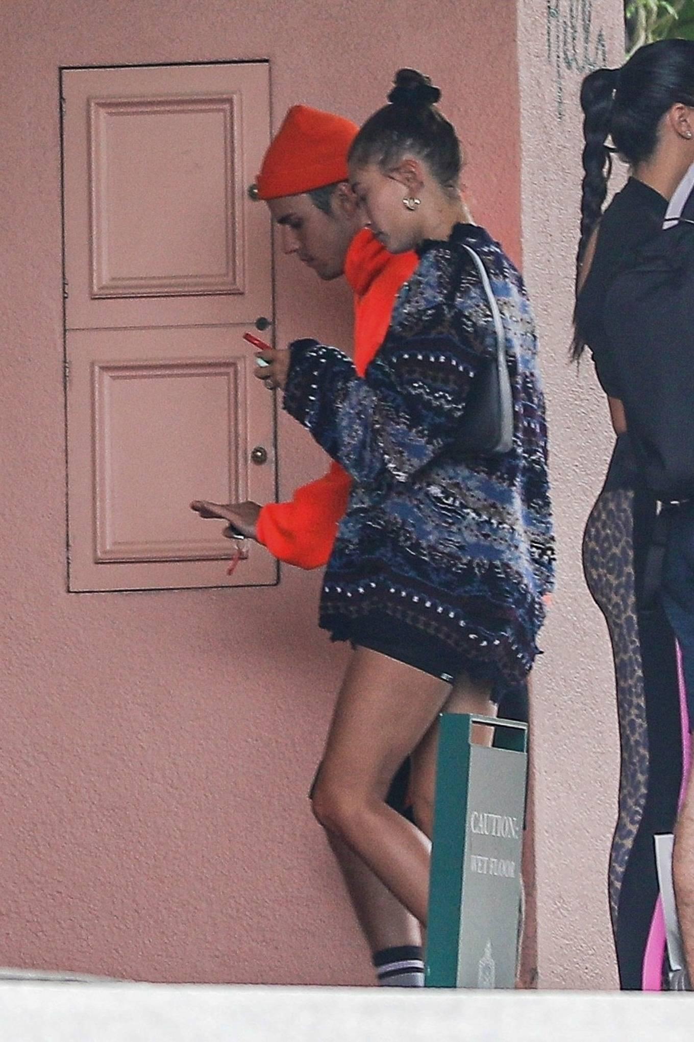 Hailey Baldwin wearing fitted black high rise shorts