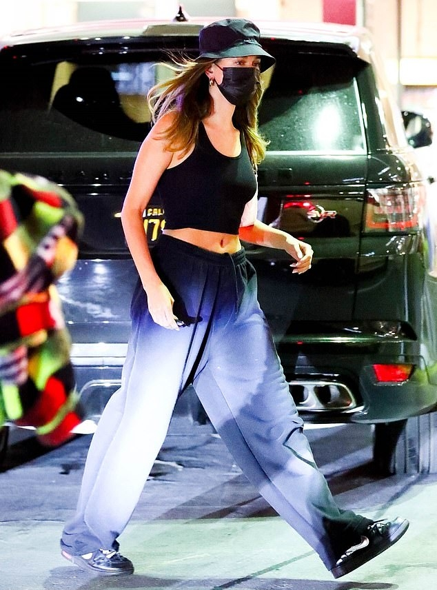 Hailey Bieber donning oversized washed blue high rise trousers