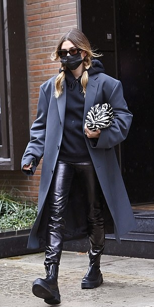 Hailey Baldwin donning shiny black trousers