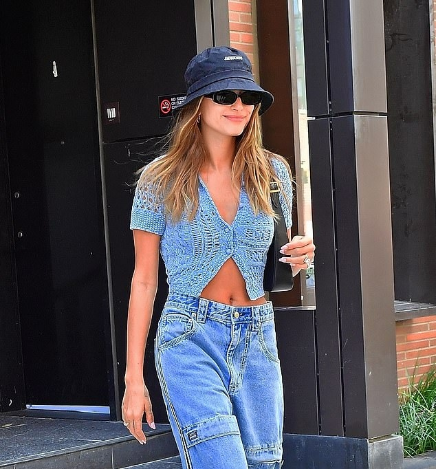 Hailey Baldwin donning square black leather high top boots by Eytys
